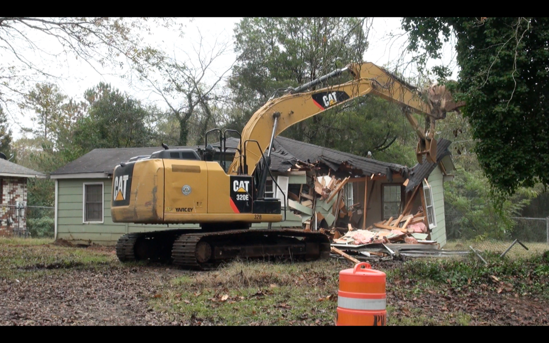 House demolition marks start of Log Cabin Drive realignment project
